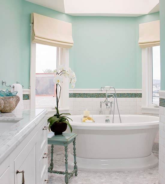 A Deep Soaking Tub Is Located In An Alcove At One End Of The Bathroom.  Surrounded By Natural Light From A Skylight And The Two Windows Overlooking  The Beach ...