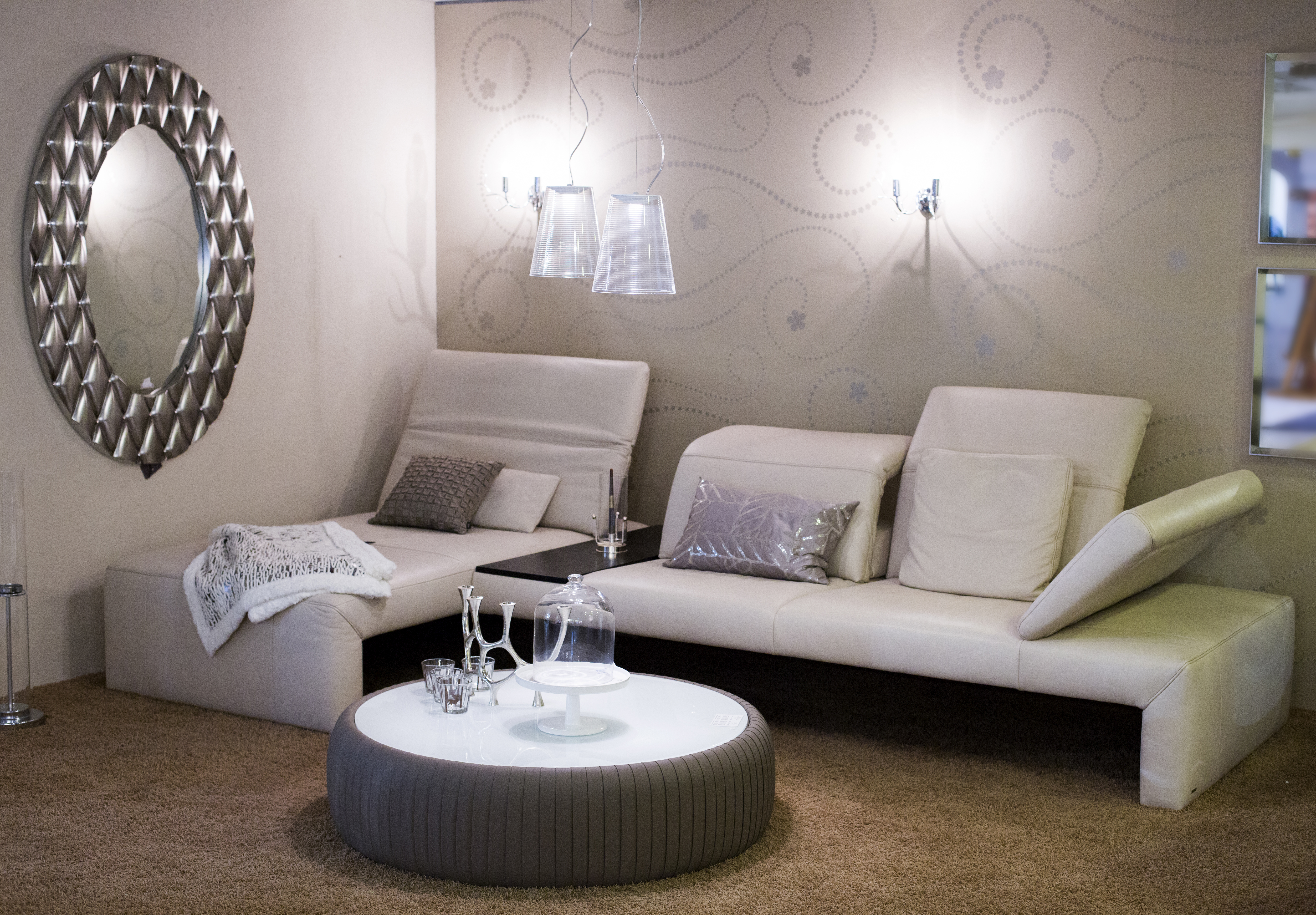 living room with white furniture, mirror and brown carpet