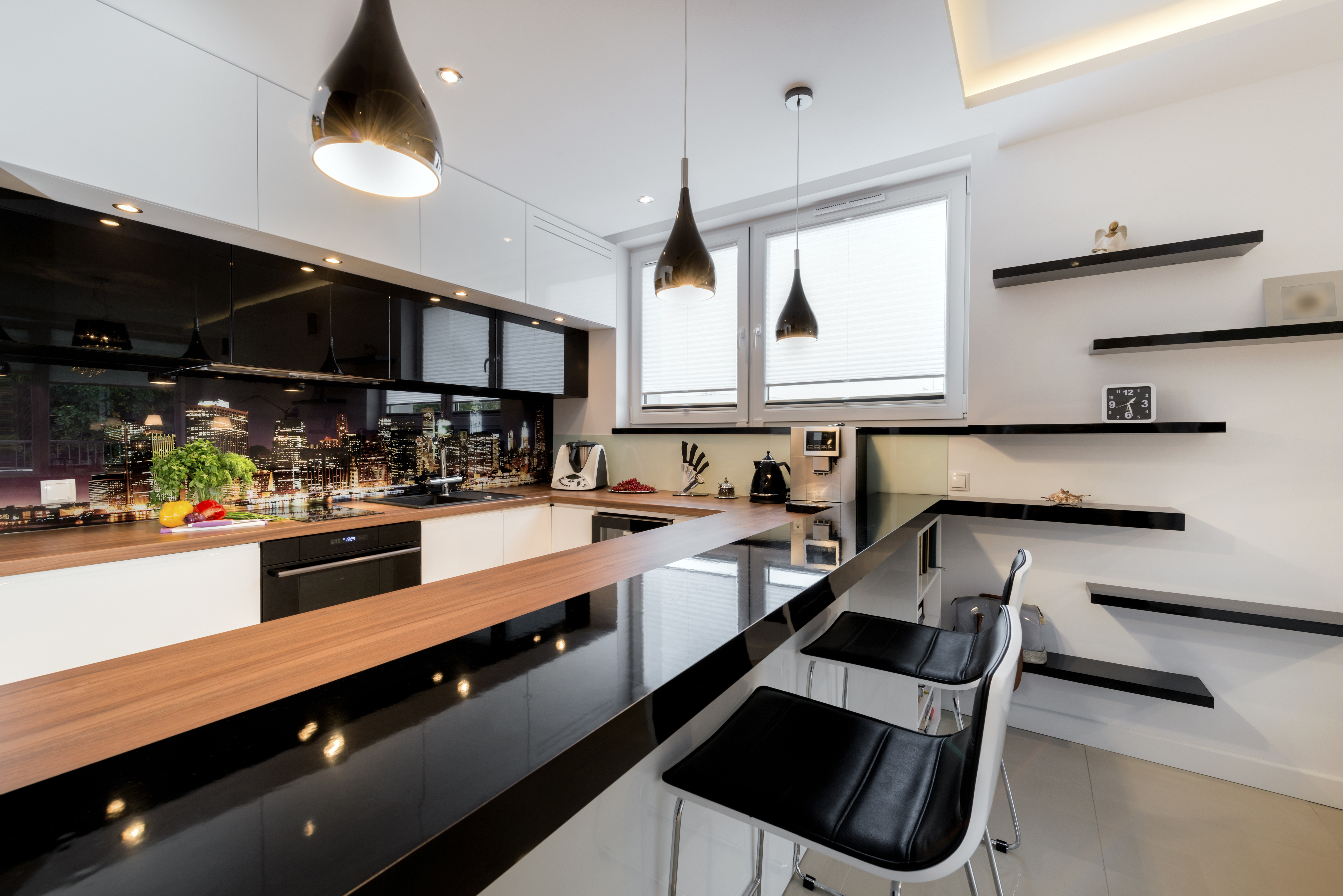 Modern open space luxury kitchen in black and white design
