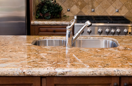 12 ways to save money on kitchen countertops otm for Granite remnant cost per square foot