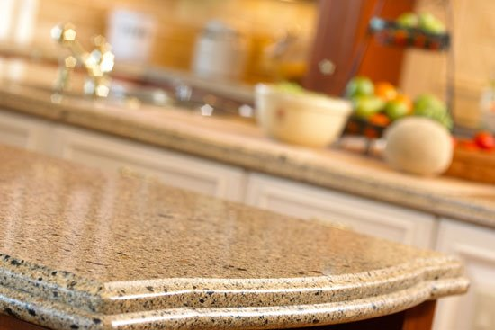 12 ways to save money on kitchen countertops otm for Countertops granite vs quartz