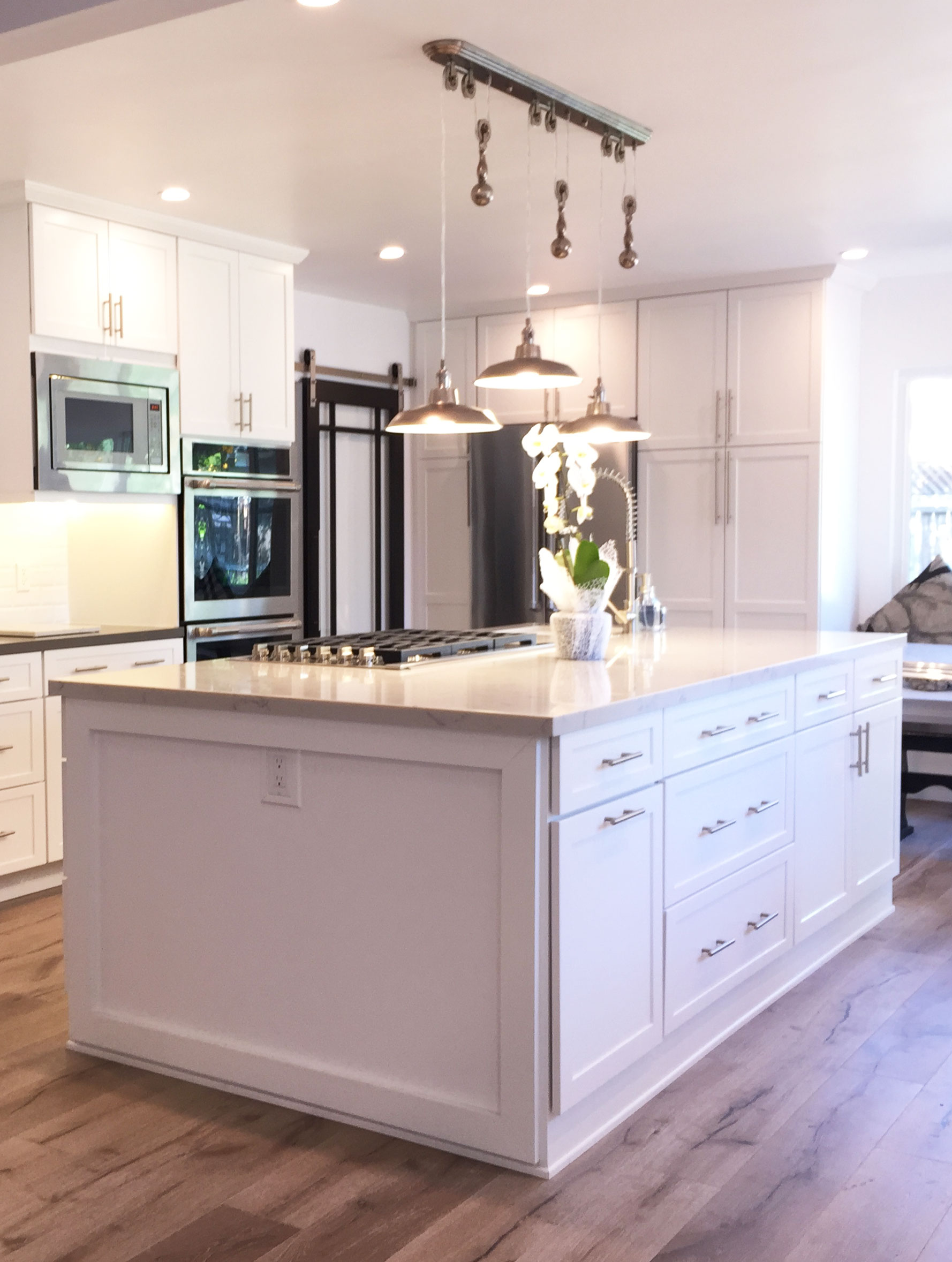Beautiful White Cabinets Featuring Brushed Nickel Finishes Brings Out The  Simplicity And Elegance In This Gorgeous Remodel. The Stainless Steel  Appliances ...